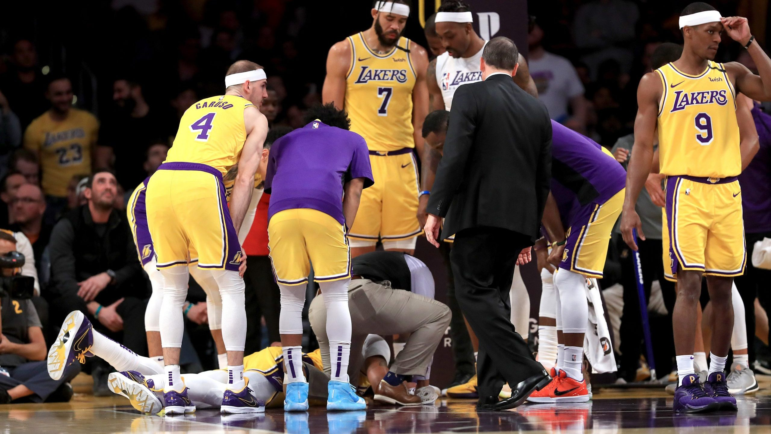Los Angeles Lakers players Alex Caruso, JaVale McGee, Rajon Rondo and Dwight Howard surround Anthony Davis as he lies on the ground during a match against the New York Knicks at Staples Center on Jan. 7, 2020 in Los Angeles. (Credit: Sean M. Haffey/Getty Images)
