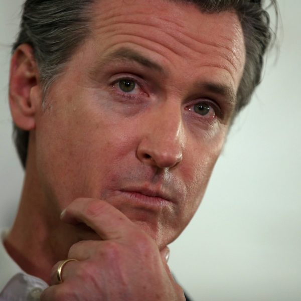 California Gov. Gavin Newsom looks on during a a news conference in Oakland about the state's efforts to address homelessness on Jan. 16, 2020. (Credit: Justin Sullivan / Getty Images)