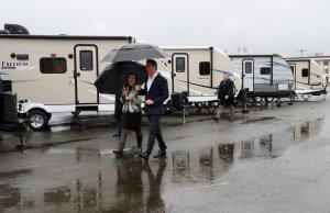 Gov. Gavin Newsom, right, walks by FEMA trailers with Oakland Mayor Libby Schaaf, right, before speaking at a news conference about the state's efforts on the homelessness crisis on Jan. 16, 2020 in Oakland. (Credit: Justin Sullivan/Getty Images)
