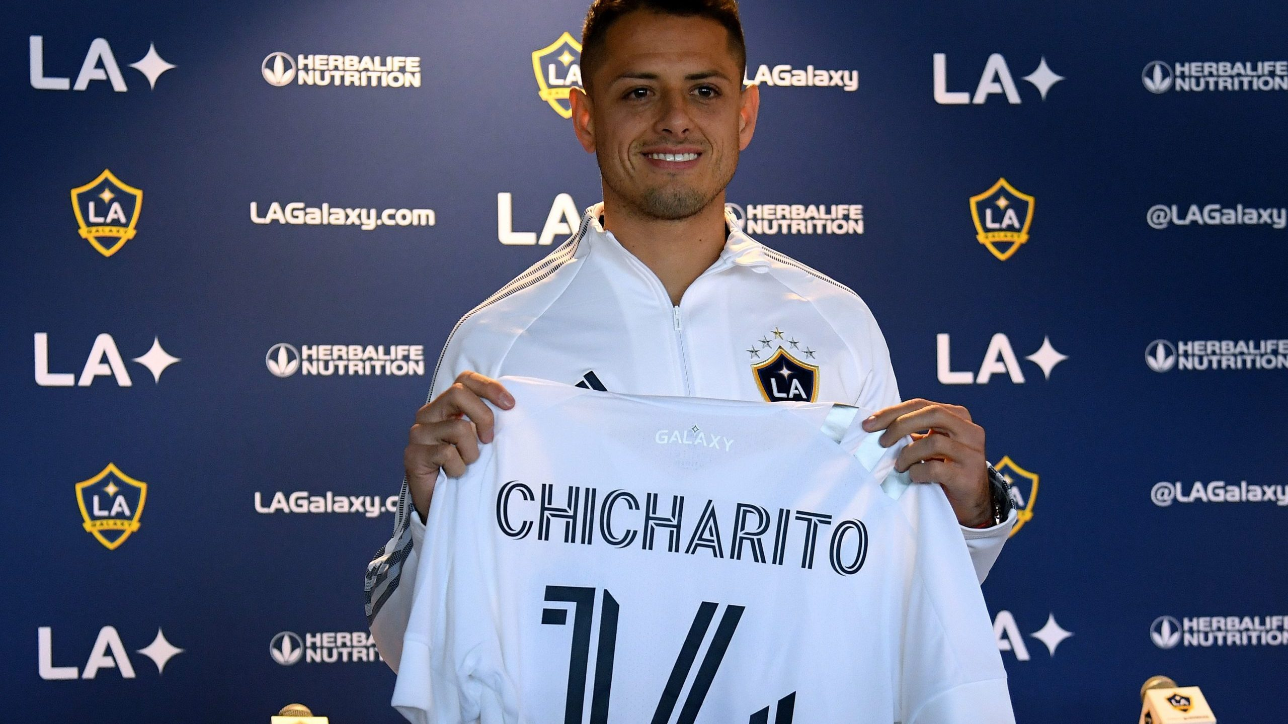 "Javier ""Chicharito"" Hernandez poses with his jersey during a press conference at Dignity Health Sports Park on Jan. 23, 2020 in Carson. (Credit: Harry How/Getty Images)"