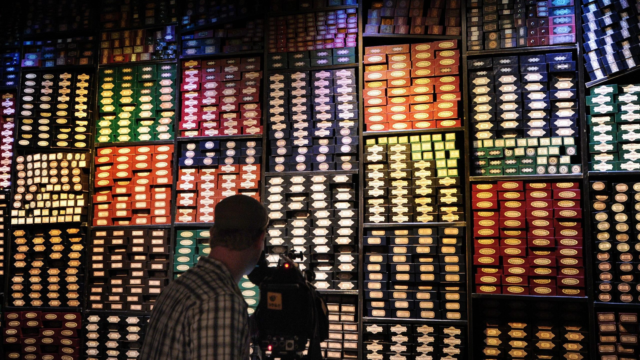 A display of wand boxes during at the Warner Bros. Harry Potter studio tour in north London on March 26, 2012. (Credit: Carl Court/AFP via Getty Images)