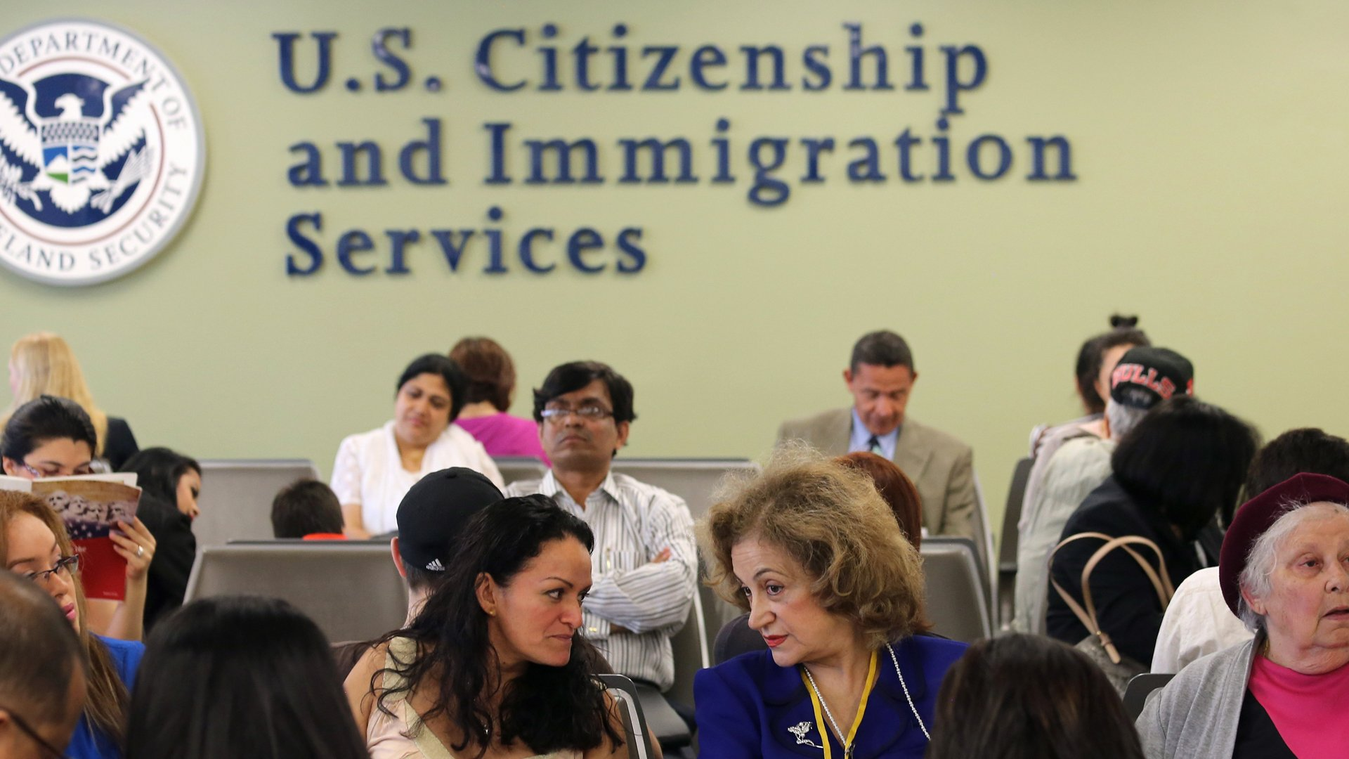 Immigrants await their turn for green card and citizenship interviews at a U.S. Citizenship and Immigration Services office on May 30, 2013, in the Queens borough of New York City. (Credit: John Moore/Getty Images)