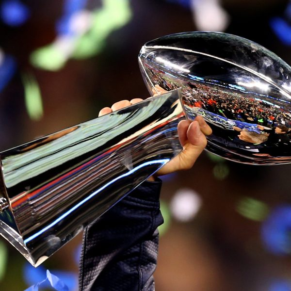 Head coach Pete Carroll of the Seattle Seahawks holds the Vince Lombardi Trophy after his team won Super Bowl XLVIII at MetLife Stadium on February 2, 2014 in East Rutherford, New Jersey. (Credit: Elsa/Getty Images)