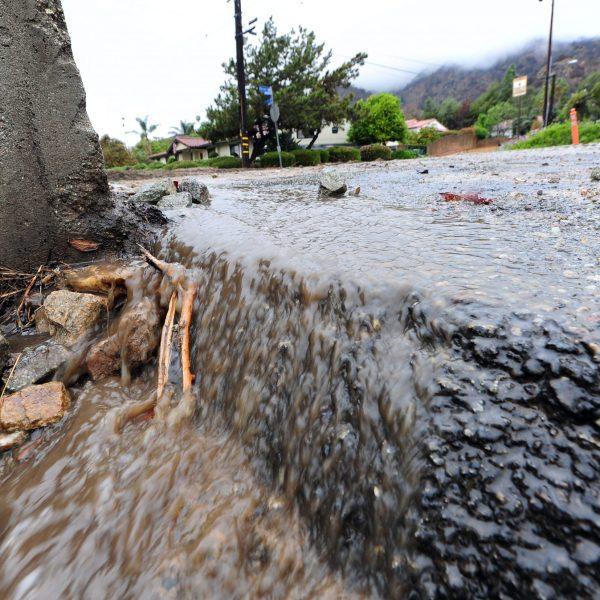 Rain water runs through a hillside neighborhood in Glendora on Feb. 28, 2014, near wildfire burn areas. (Credit: Frederic J. Brown/AFP via Getty Images)