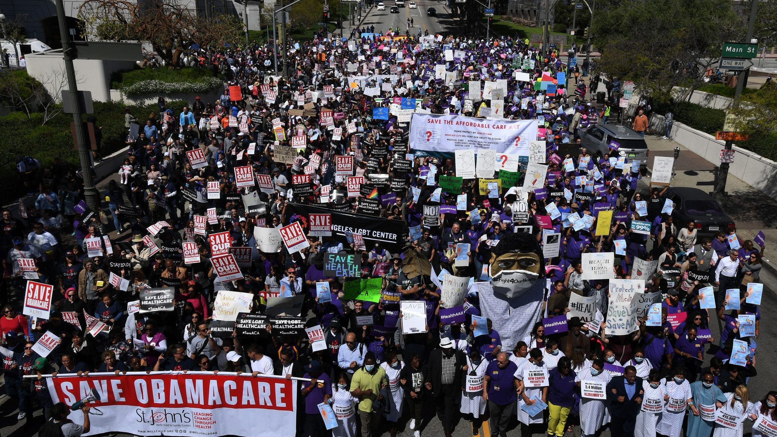 "Protesters march towards the Federal Building during a ""Save the Affordable Care Act"" rally in Los Angeles on March 23, 2017. (Credit: MARK RALSTON/AFP via Getty Images)"