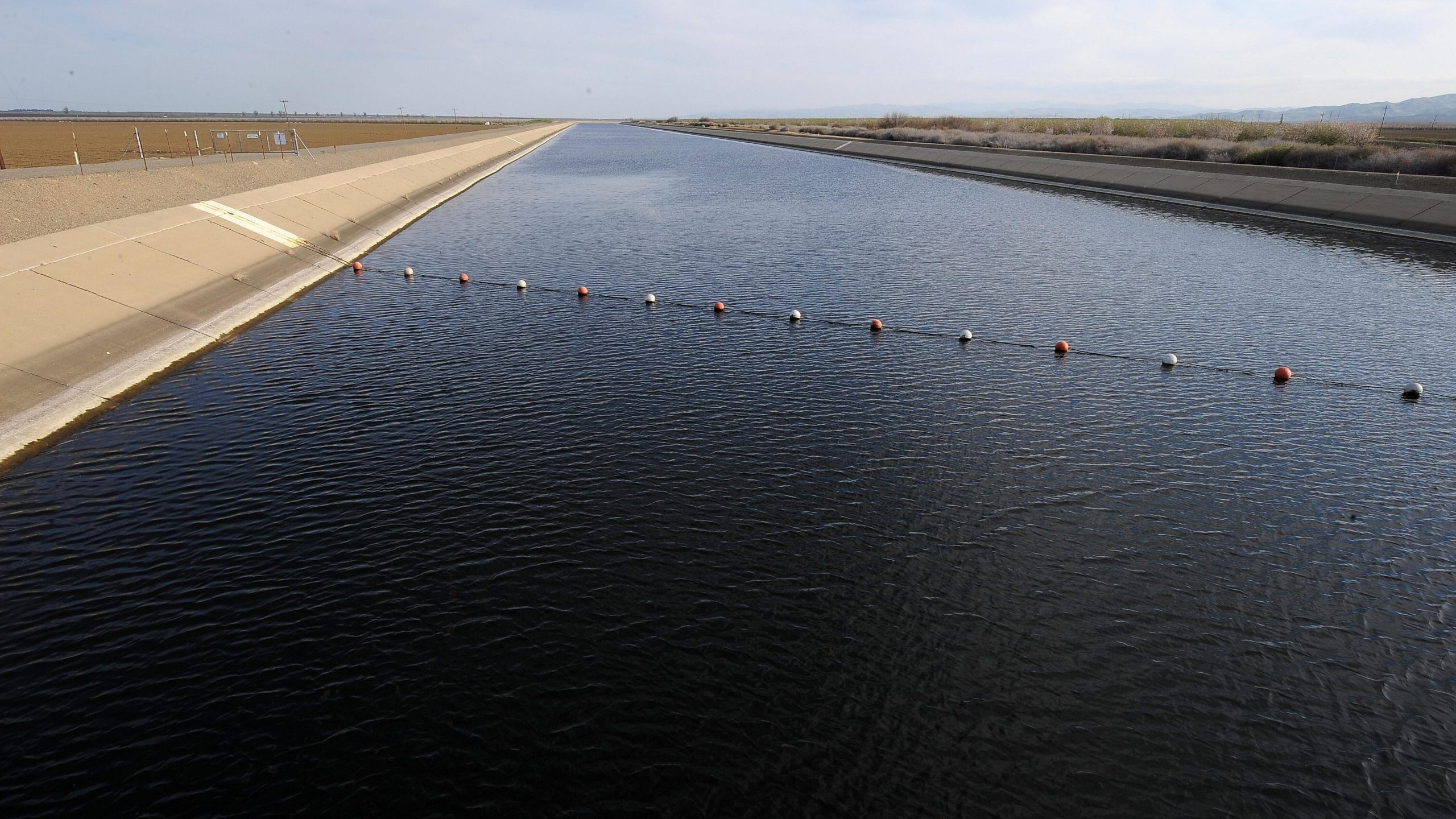 The California Aqueduct at Mendota carries water from the San Joaquin-Sacramento River Delta in the north to farms and cities in the central and southern part of the state on March 11, 2009. (Credit: Robyn Beck/AFP via Getty Images)