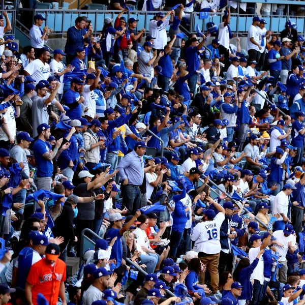 Fans look on during game six of the 2017 World Series between the Houston Astros and the Los Angeles Dodgers at Dodger Stadium on Oct. 31, 2017. (Credit: Joe Scarnici/Getty Images)