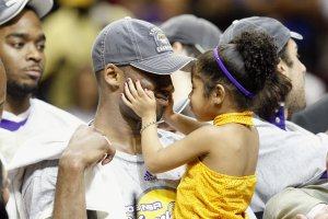 Kobe Bryant holds his daughter, Gianna, after the Lakers defeated the Orlando Magic in Game Five of the 2009 NBA Finals on June 14, 2009, at Amway Arena in Orlando, Florida. (Credit: Ronald Martinez/Getty Images)