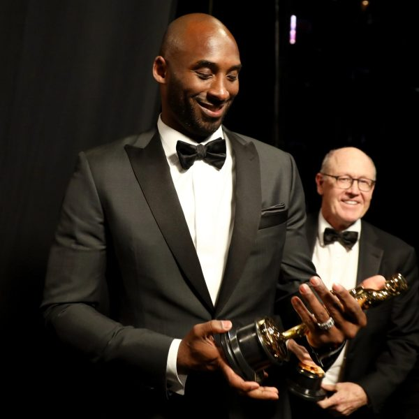 """Kobe Bryant holds his award for Best Animated Short Film for """"Dear Basketball"""" at the 90th Annual Academy Awards at the Dolby Theatre on March 4, 2018 in Hollywood. (Credit: Matt Sayles/A.M.P.A.S via Getty Images)"""