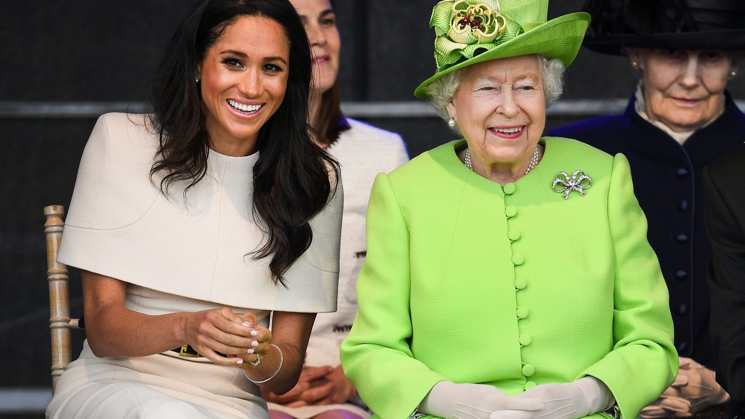 Queen Elizabeth II sits with Meghan, Duchess of Sussex, during a ceremony to open the new Mersey Gateway Bridge on June 14, 2018 in the town of Widnes in Halton, Cheshire, England. (Credit: Jeff J Mitchell/Getty Images)