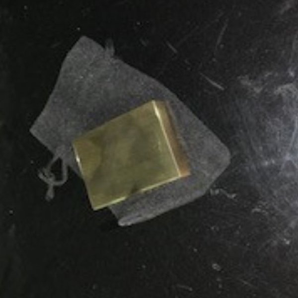 "Detectives are seeking a man and woman who swindled an 80-year-old woman out of $4K by persuading her to buy this purported ""gold brick"" for $4,000 on Oct. 10, 2019. It was fake. (Credit: Los Angeles County Sheriff's Department)"