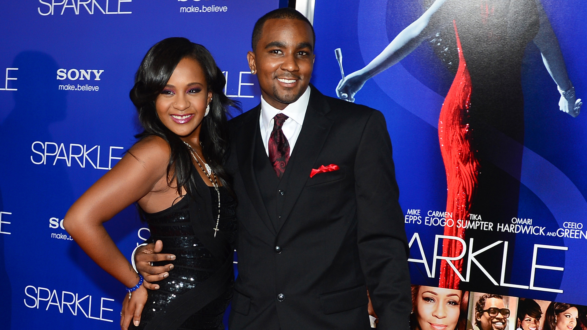 """Whitney Houston's daughter Bobbi Kristina Brown and her boyfriend Nick Gordon arrive for the premiere of """"Sparkle"""" at Grauman's Chinese Theater in Hollywood, California on August 16, 2012. (Credit: Frederic J. Brown/AFP/Getty Images)"""