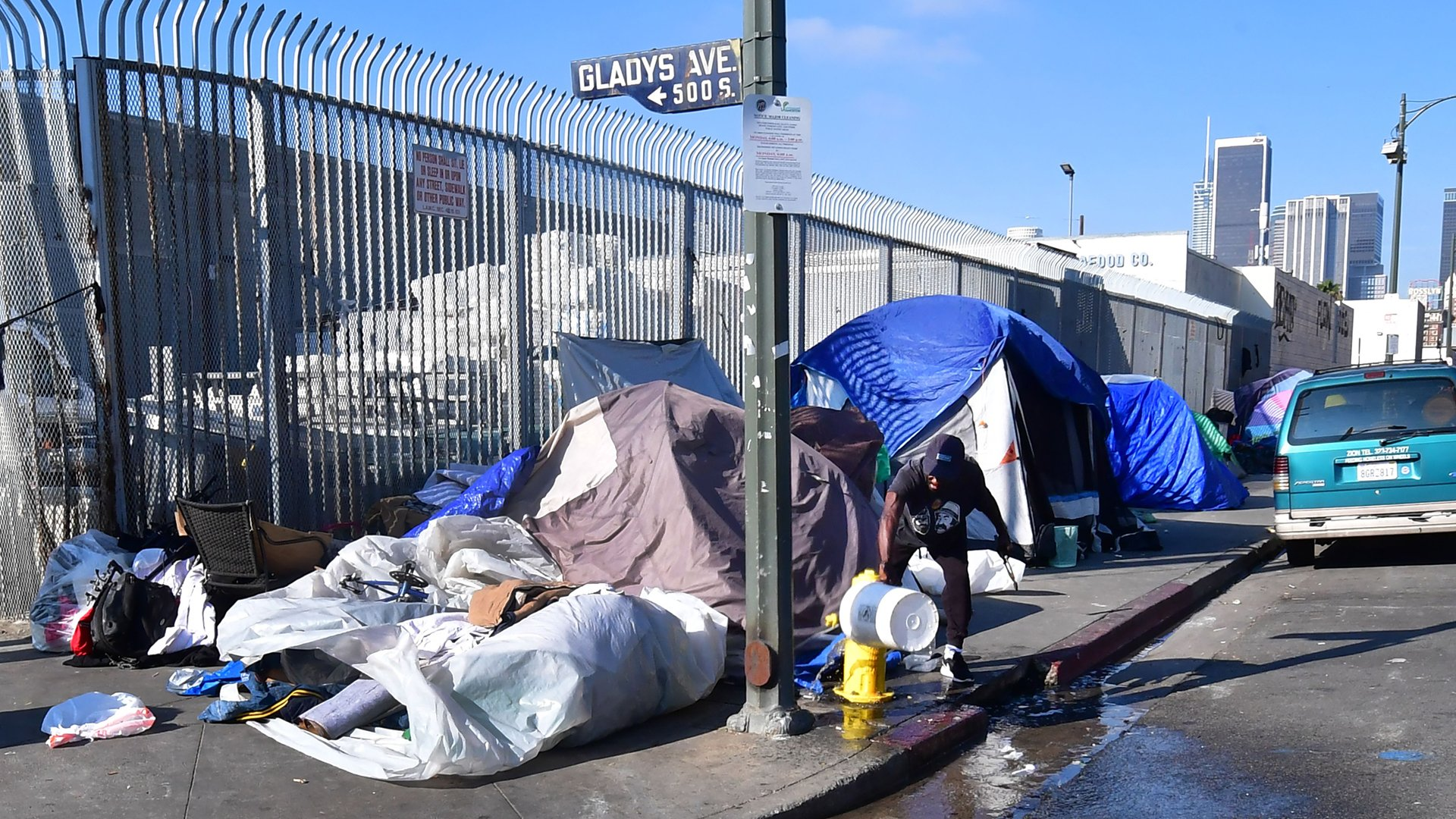 Tents of the homeless line a street corner in Los Angeles on Jan. 8, 2020. (Credit: Frederic J. BROWN / Getty)