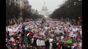 Protesters at the Women's March walk down Pennsylvania Avenue in Washington, D.C., on Jan. 21, 2017. (Credit: Mario Tama/Getty Images via CNN)