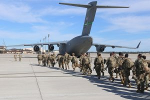 This handout picture released by the US Army shows paratroopers assigned to the 2nd Battalion, 504th Parachute Infantry Regiment, 1st Brigade Combat Team, 82nd Airborne Division, deploy from Pope Army Airfield, North Carolina on January 1, 2020. - Paratroopers from 2nd Battalion, 504th Parachute Infantry Regiment, 1st Brigade Combat Team, 82nd Airborne Division were activated and deployed to the U.S. Central Command area of operations in response to recent events in Iraq. (Credit: Capt. Robyn Haake/U.S. ARMY/AFP/Getty Images)