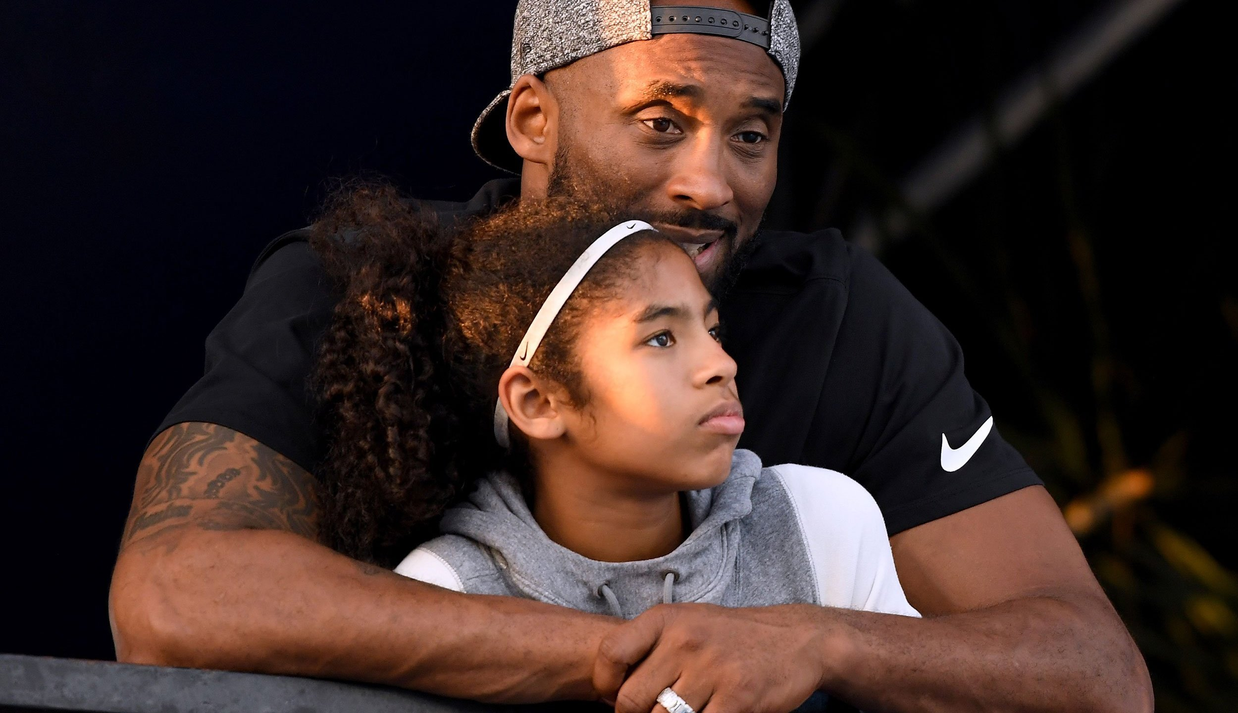 (*to be used with this article only) Kobe Bryant and daughter Gianna Bryant watch during day 2 of the Phillips 66 National Swimming Championships at the Woollett Aquatics Center on July 26, 2018 in Irvine, California. (Credit: Harry How/Getty Images)