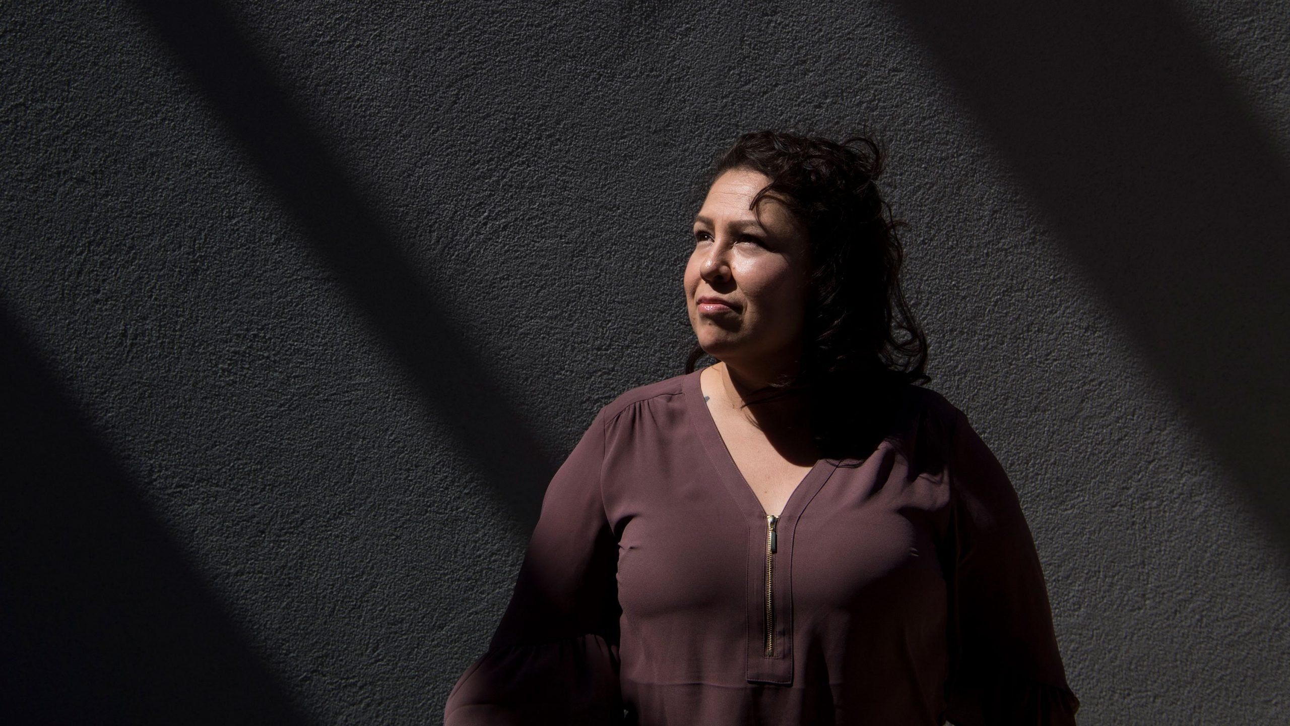 Ruby Torres stands for a portrait in her apartment complex in Phoenix, Arizona on July 4, 2018. (Credit: Carolyn Van Houten/The Washington Post via Getty Images)