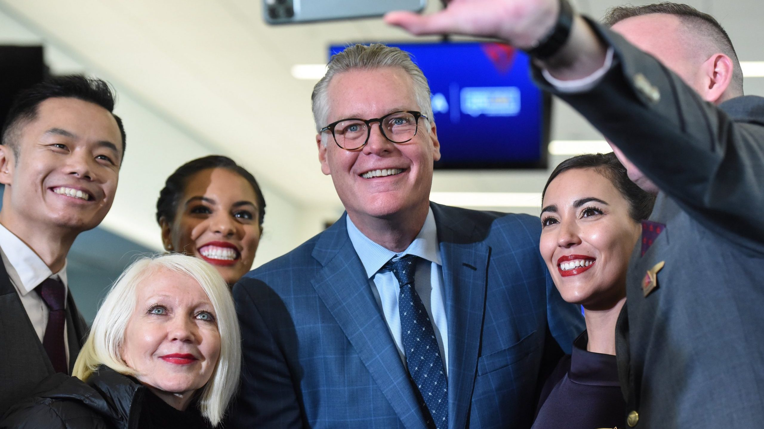 Delta CEO Ed Bastian and employees are pictured on October 29, 2019 in New York City. (Credit: Stephanie Keith/Getty Images)