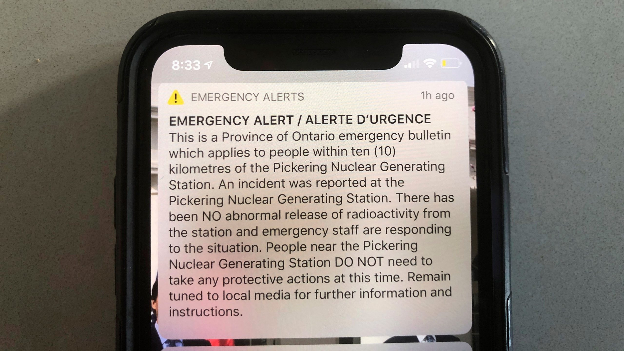 "An emergency alert issued by the Canadian province of Ontario reporting an unspecified ""incident"" at a nuclear plant is shown on a smartphone Sunday, Jan. 12, 2020. Ontario Power Generation later sent a message saying the alert ""was sent in error."" The initial message said the incident had occurred at the Pickering Nuclear Generating Station, though it added there had been no abnormal release of radioactivity from the station. (AP Photo/Robert Gillies via CNN)"
