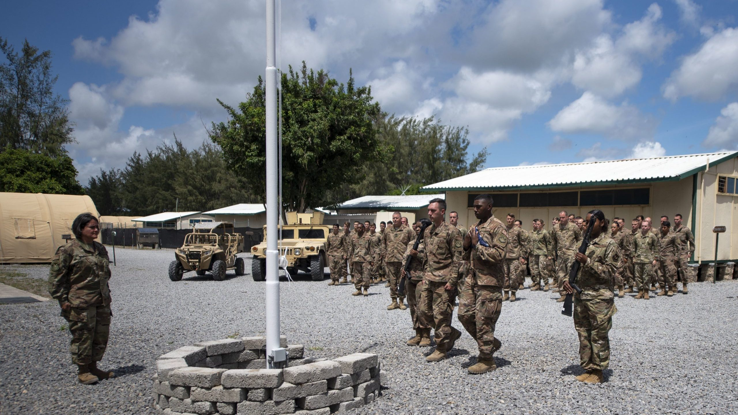U.S. Air Force Airmen from the 475th Expeditionary Air Base Squadron conduct a flag-raising ceremony at Camp Simba, Kenya, on Aug. 26, 2019. (Credit: U.S. Air Force/ Staff Sgt. Lexie West via CNN)
