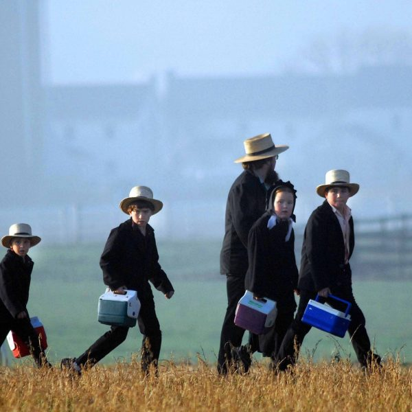 Amish children head to their newly built schoolhouse April 2, 2007. in Nickel Mines, Pennsylvania. (Credit: William Thomas Cain/Getty Images)