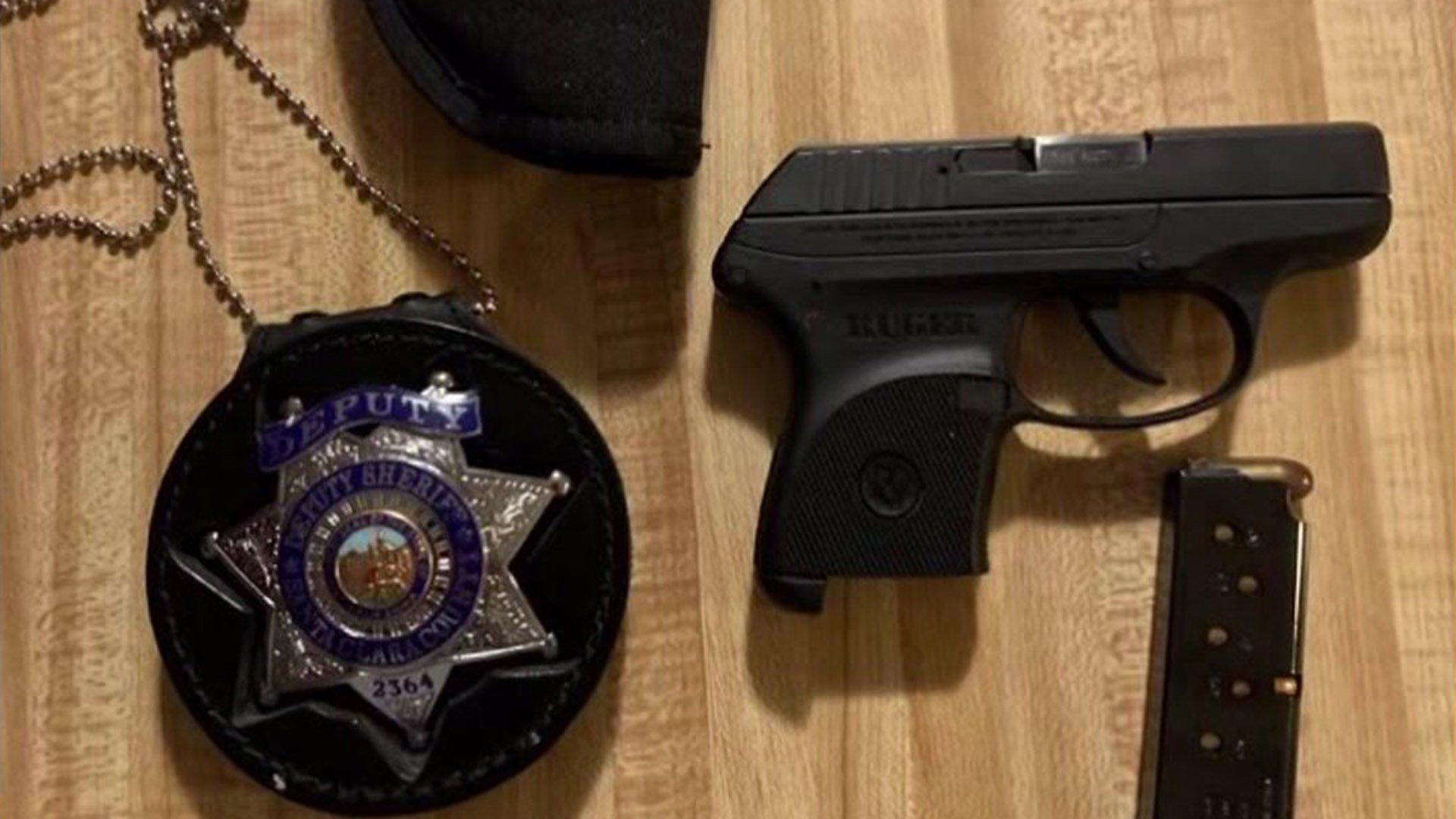 A gun and badge found at a South Lake Tahoe rental. (Credit: KTXL)