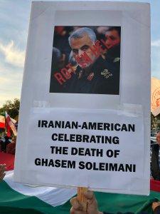 An Iranian American holds up a sign celebrating the killing of Gen. Qassem Soleimani in Westwood on Jan. 4, 2020. (Credit: KTLA)