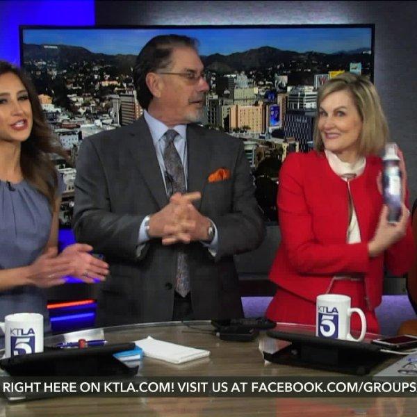 "Don Corsini, center left, applauds incoming KTLA general manager Janene Drafs, who holds the ""baton"" on 5 Live on Jan. 23, 2020."