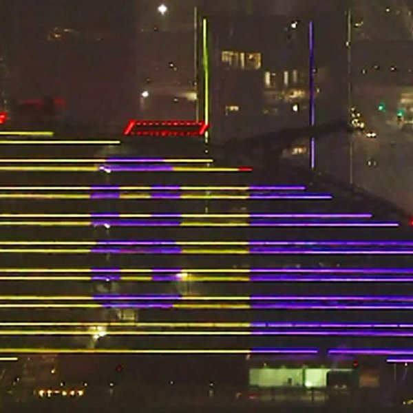The Intercontinental Hotel at Wilshire Grand Center honors Kobe Bryant by displaying his original number 8 with the Los Angeles Lakers on Jan. 26, 2020. (Credit: KTLA)