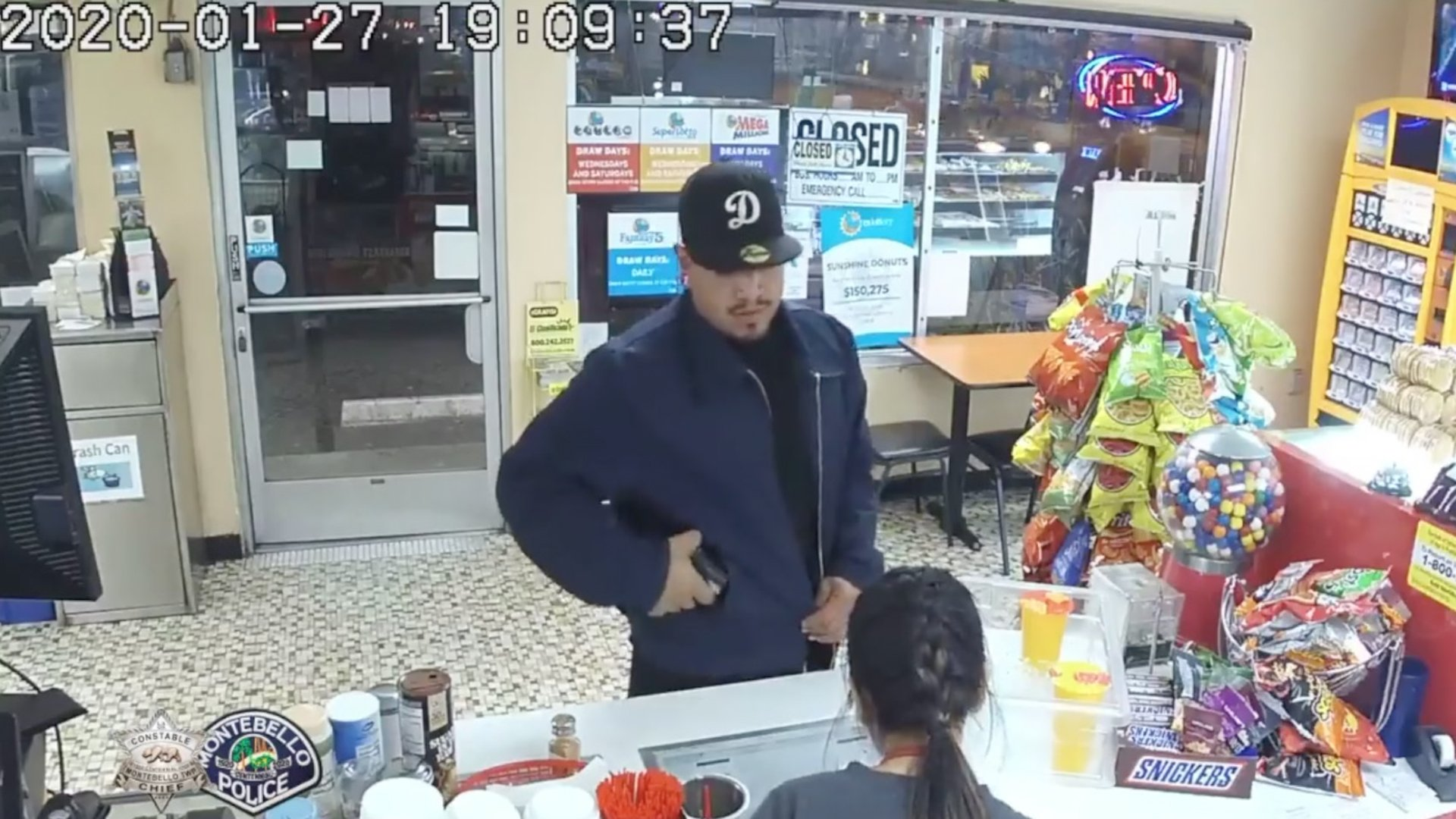 Detectives are seeking the man pictured in this surveillance photo in connection with an armed robbery at a Montebello donut shop on Jan. 27, 2020. (Credit: Montebello Police Department)