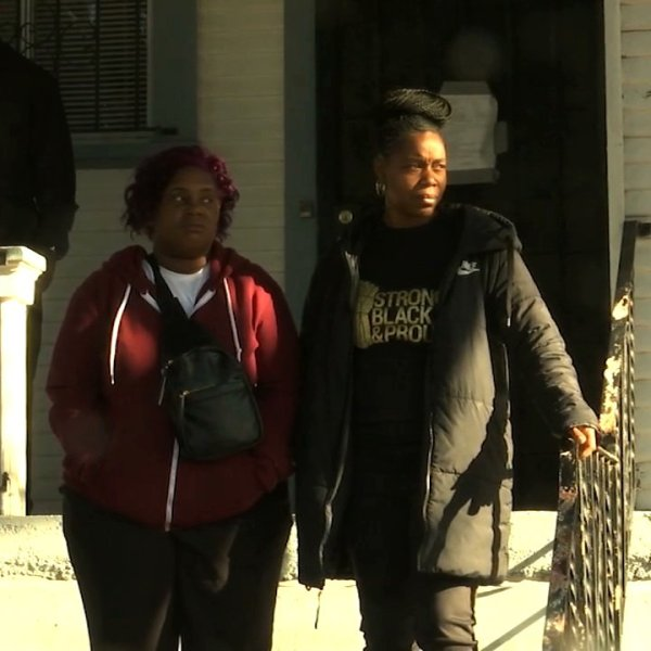 Moms 4 Housing members stand outside an Oakland house the group has been occupying on Jan. 10, 2020. (Credit: KRON)