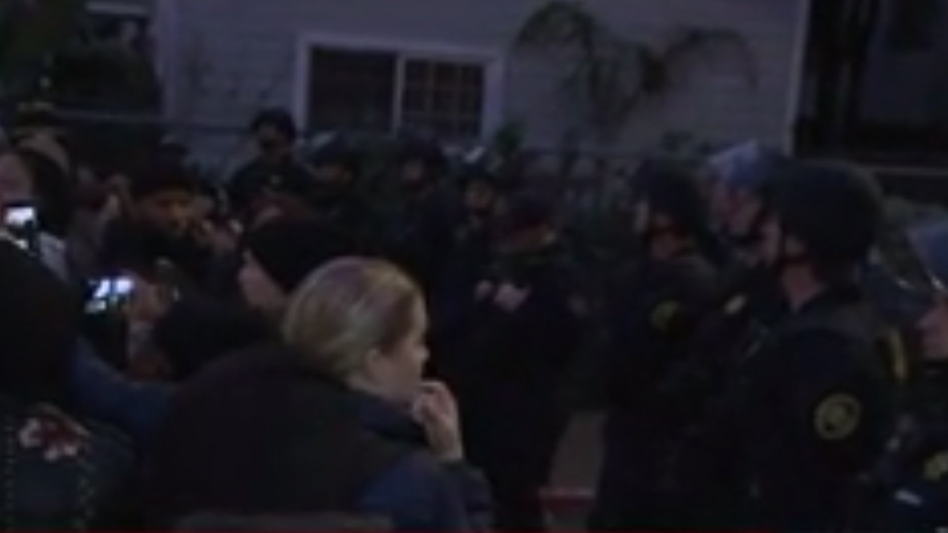 Armed deputies and protesters outside a home where four squatting mothers were evicted on Jan. 14, 2020. (Credit: KPIX via CNN)