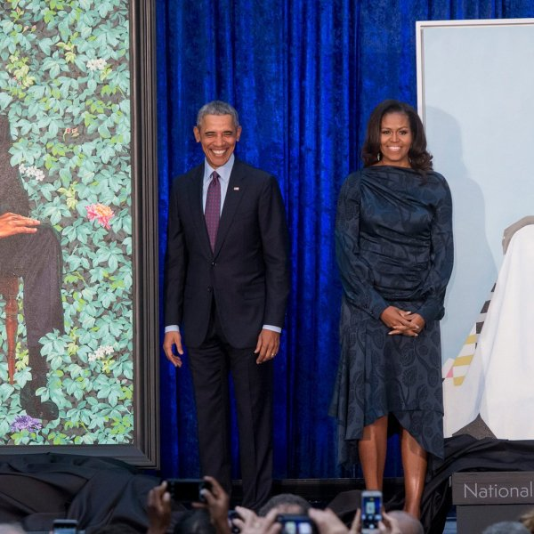 The Obamas stand beside their portraits after their unveiling at the Smithsonian's National Portrait Gallery in Washington, DC, on Feb. 12, 2018. (Credit: SAUL LOEB/AFP/Getty Images)