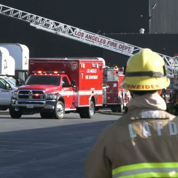 Firefighters respond after a worker was burned in an explosion at a business in Pacoima on Jan. 22, 2020. (Credit: OnScene.TV)