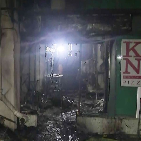 Fire crews inspect a pizzeria that caught fire in Koreatown on Jan. 15, 2020. (Credit: KTLA)