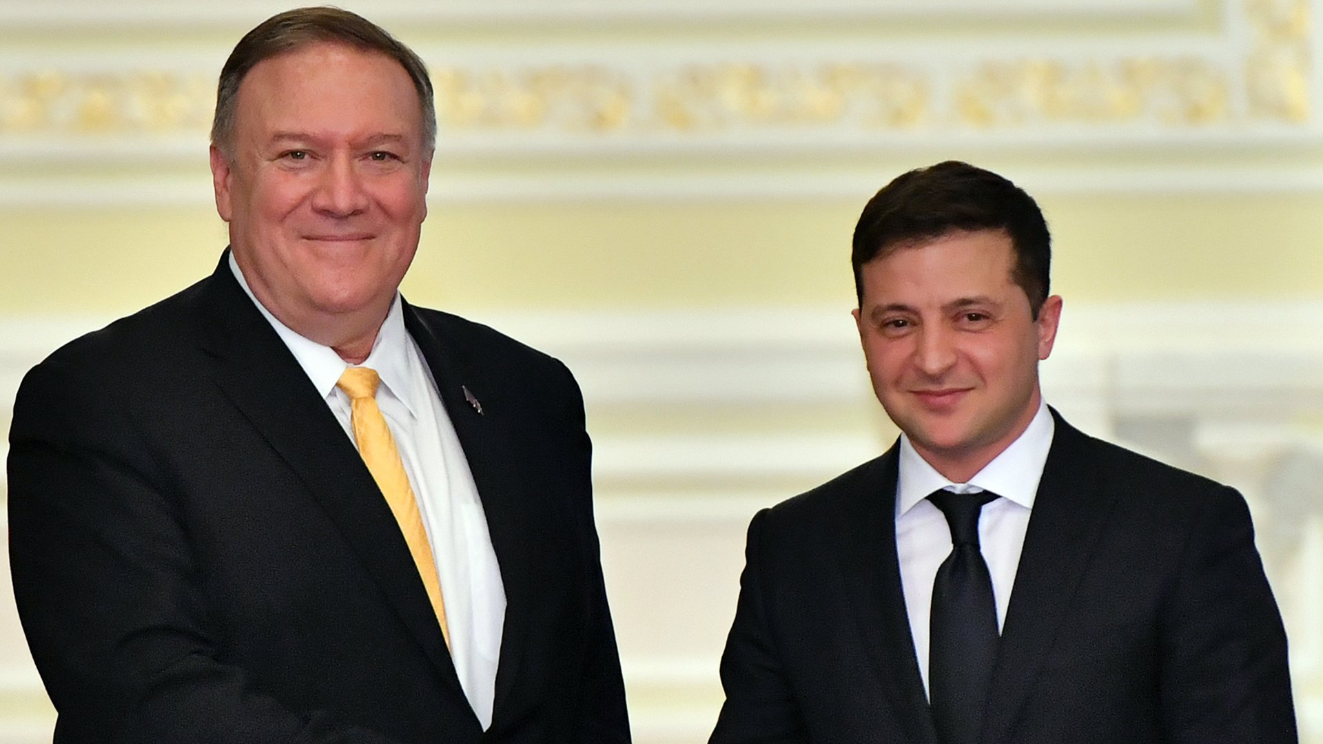 U.S. Secretary of State Mike Pompeo and Ukraine's President Volodymyr Zelensky shake hands as they address the media following their meeting in Kiev on Jan. 31, 2020. (Credit: Sergei SUPINSKY/ AFP via Getty Images)