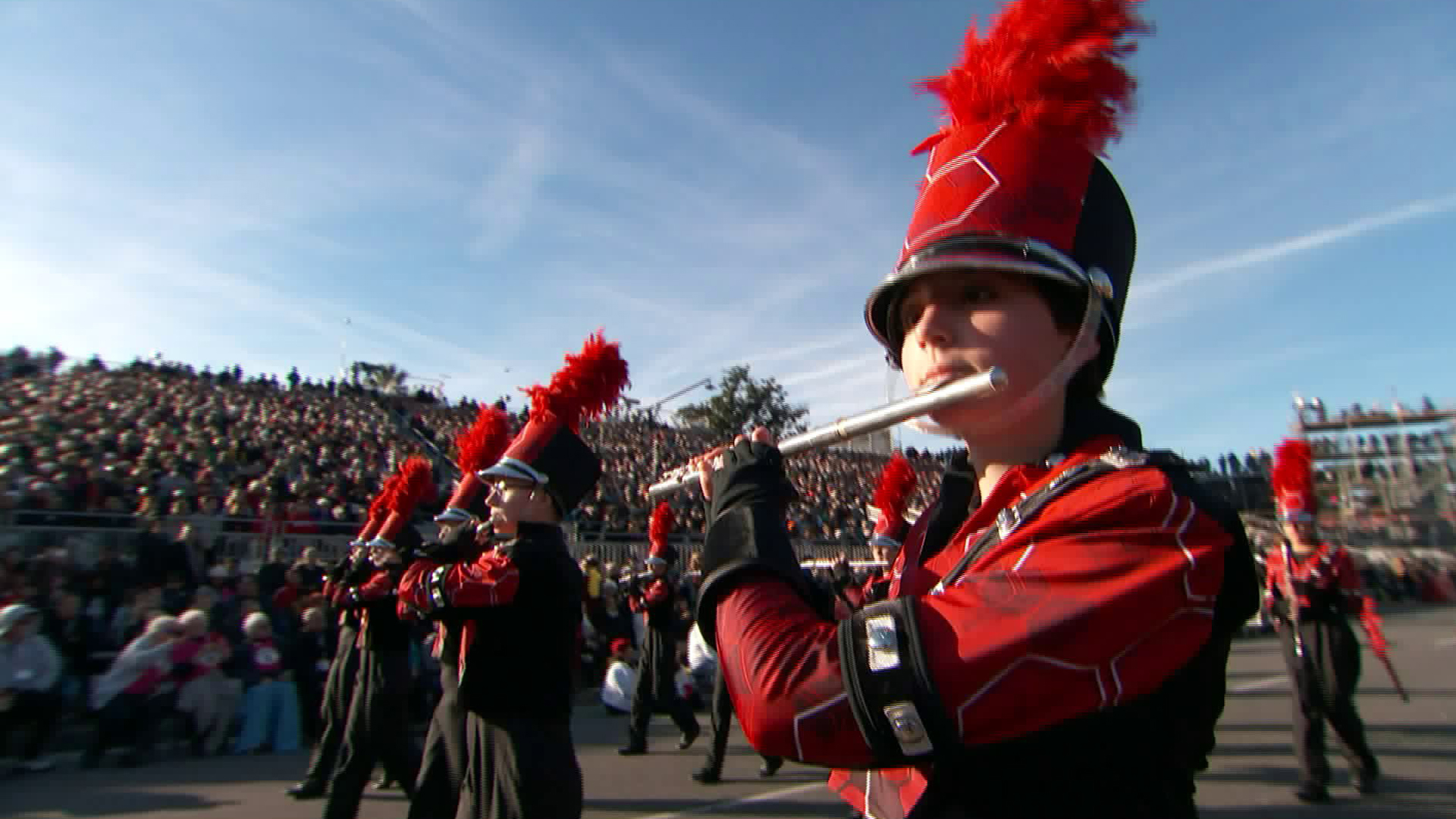 Spectators watch as the Baldwinsville marching band passes by during the Rose Parade on Jan. 1, 2020. (Credit: KTLA)