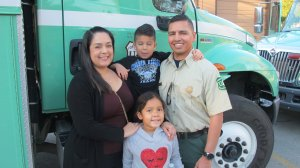 Angeles National Forest Fire Service firefighter Hector Cerna is seen with his family before traveling to Australia on Jan. 6, 2020. (Credit: CNN)