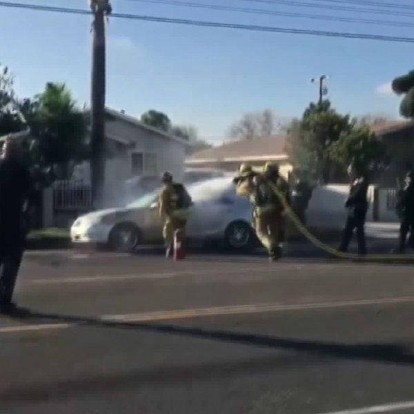 An OCFA firefighter hosed down a man who had doused himself with gasoline in Santa Ana on Jan. 22, 2020. (Credit: Santa Ana Police Department)