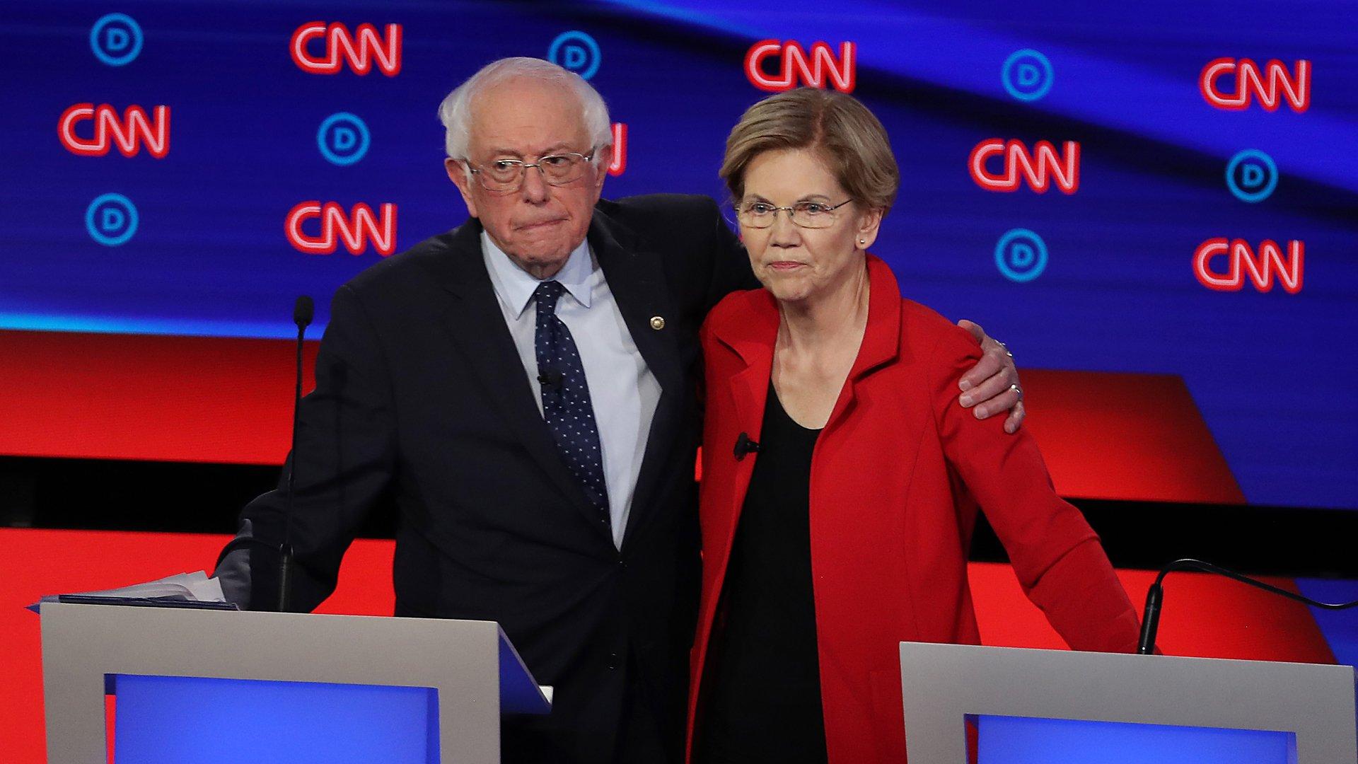 Democratic presidential candidate Sen. Bernie Sanders (I-VT) (L) and Sen. Elizabeth Warren (D-MA) embrace after the Democratic Presidential Debate at the Fox Theatre July 30, 2019 in Detroit. (Credit: Justin Sullivan/Getty Images)