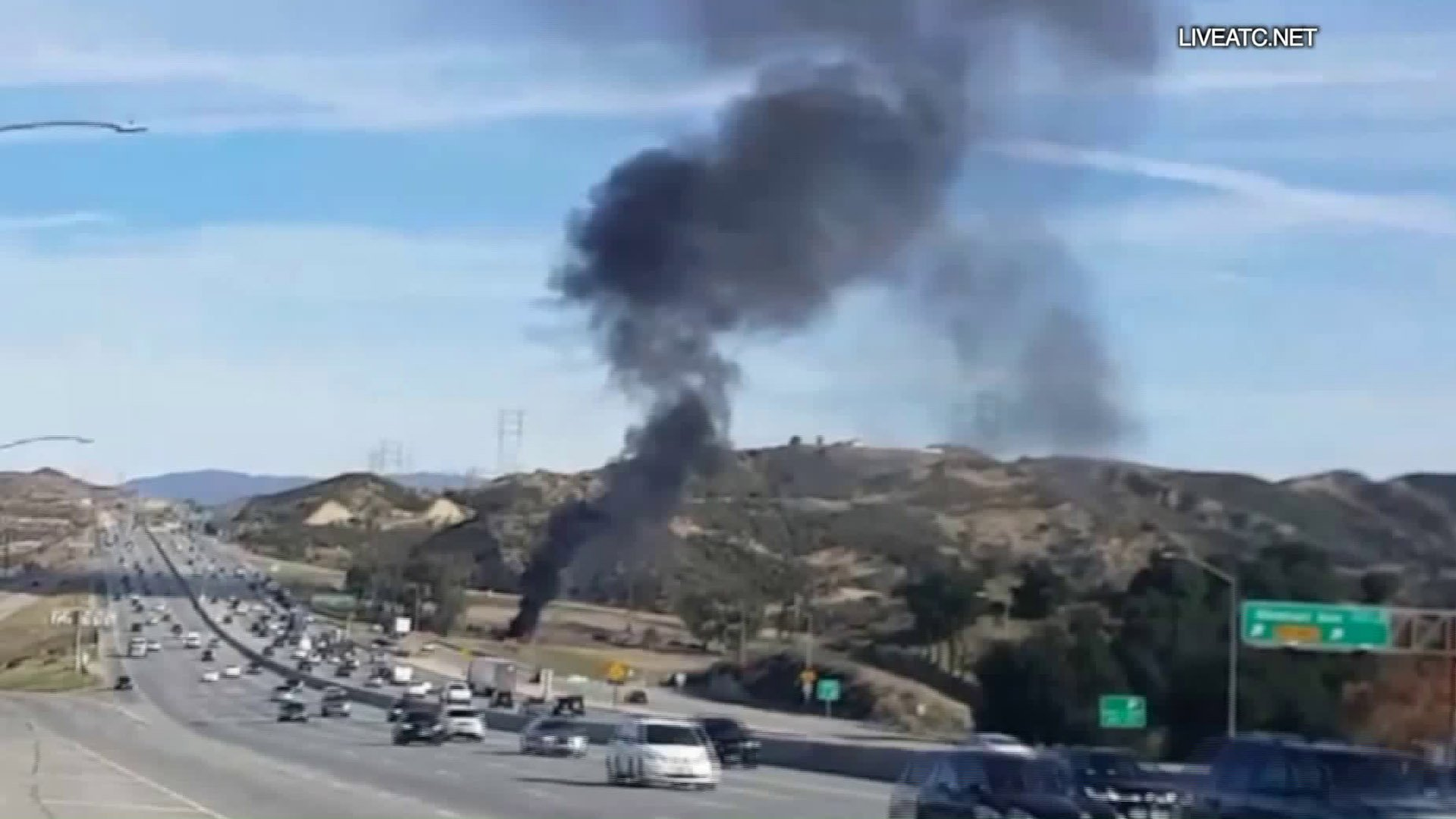 Black smoke rises from a small plane that crashed near the 14 Freeway in Santa Clarita on Jan. 4, 2019. (Credit: Liveatc.net)
