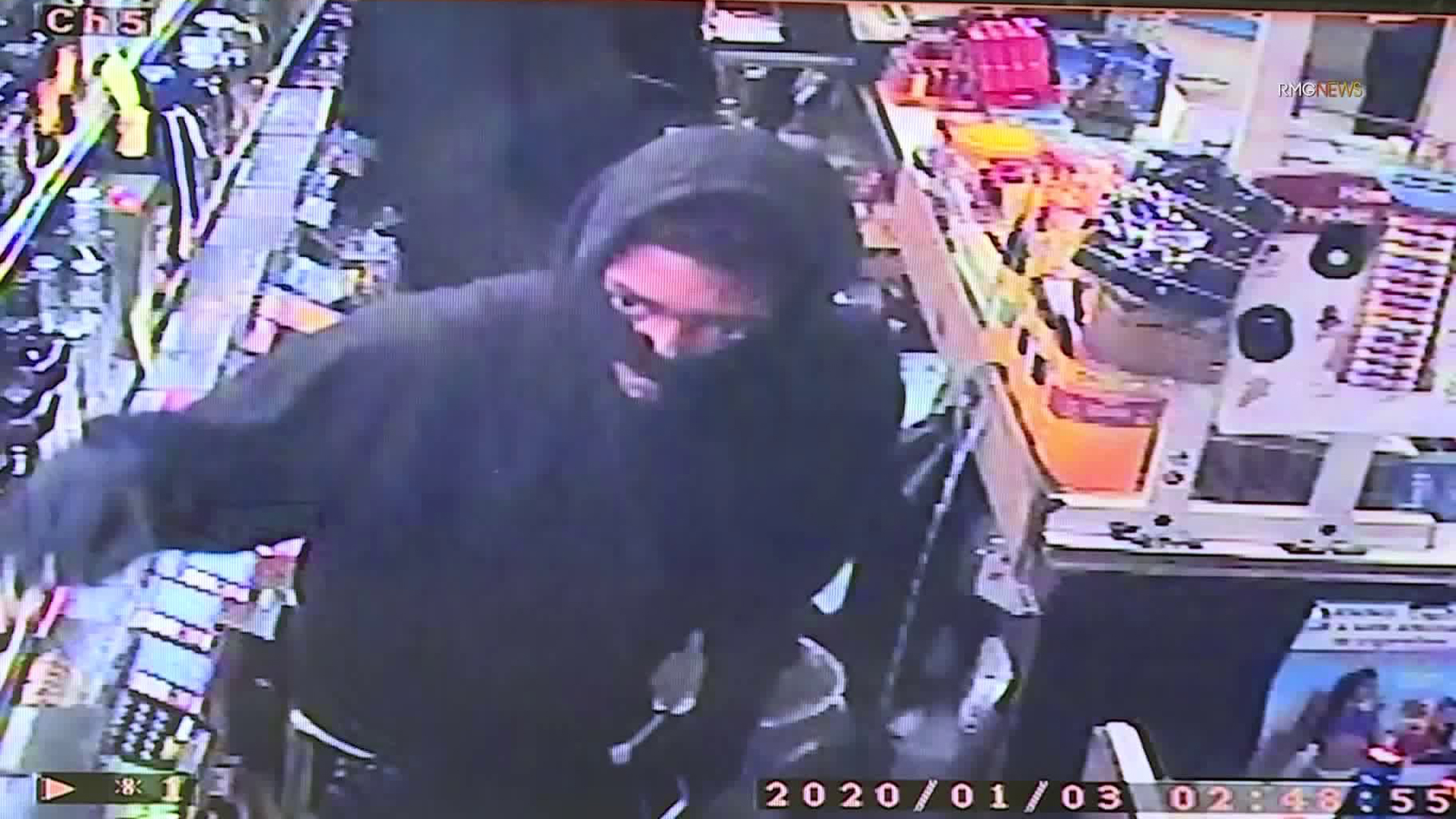 An armed robbery suspect is seen in a surveillance image provided by Lucky 7 Liquor in Culver City.