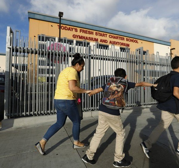 A parent and students walk by the Today's Fresh Start Charter School gym and auditorium in Inglewood in this undated photo. (Credit: Mel Melcon / Los Angeles TImes)