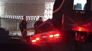 A car is seen after it was hit by an oncoming Metrolink train in Santa Ana on Jan. 6, 2020. (Credit: OC Hawk)