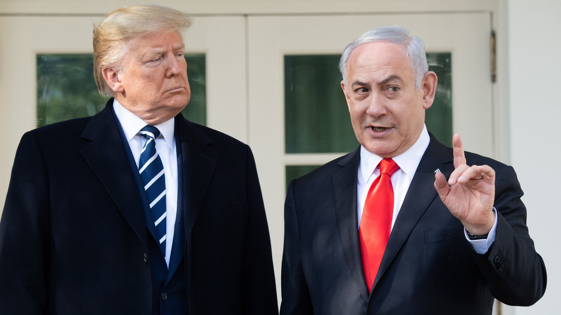 US President Donald Trump and Israeli Prime Minister Benjamin Netanyahu (R) speak to the press on the West Wing Colonnade prior to meetings at the White House in Washington, DC, January 27, 2020. (Credit: SAUL LOEB/AFP via Getty Images)