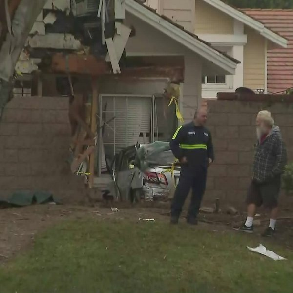 A car plowed into a Tustin home on Jan. 25, 2020. (Credit: KTLA)