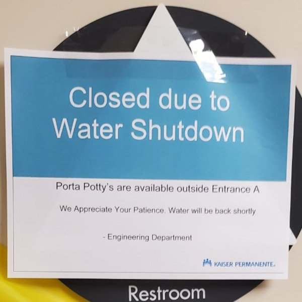A sign posted at Kaiser Permanente Medical Center in Woodland Hills as the hospital dealt with a water main break on Jan. 19, 2020, pictured in a photo provided to KTLA.