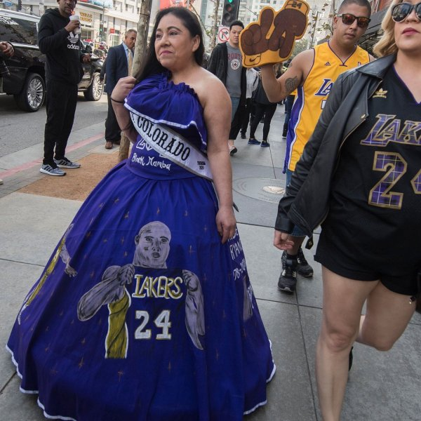 Franchesca Flores, 43, arrived outside Staples Center on Feb. 24, 2020, in a hand-painted purple ball gown with images of Kobe and Gianna Bryant shooting hoops. (Credit: MARK RALSTON/AFP via Getty Images)