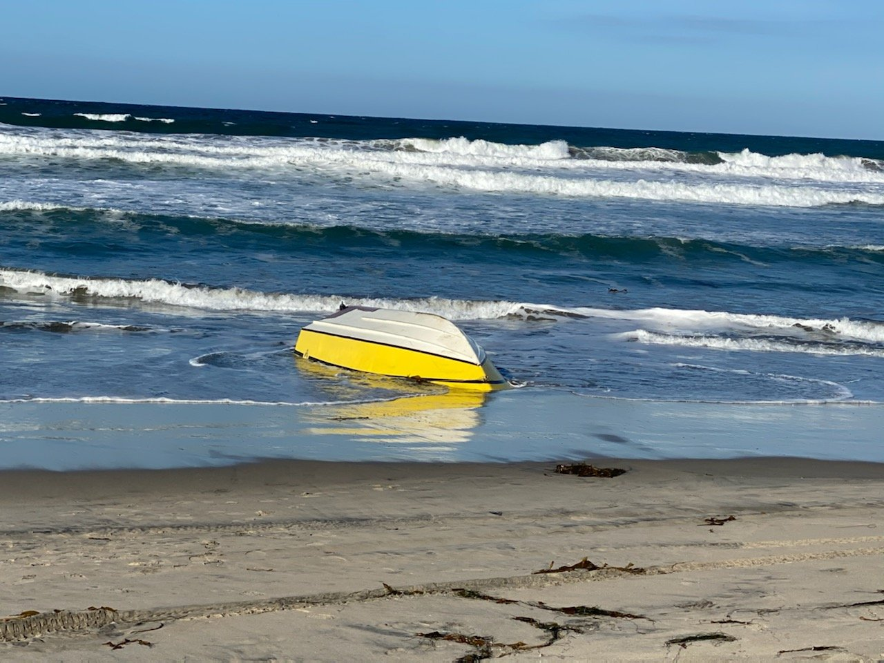 A suspected smuggling boat is seen after it capsized off the coast of Imperial Beach on Feb. 3, 2020. (Credit: U.S. Border Patrol)