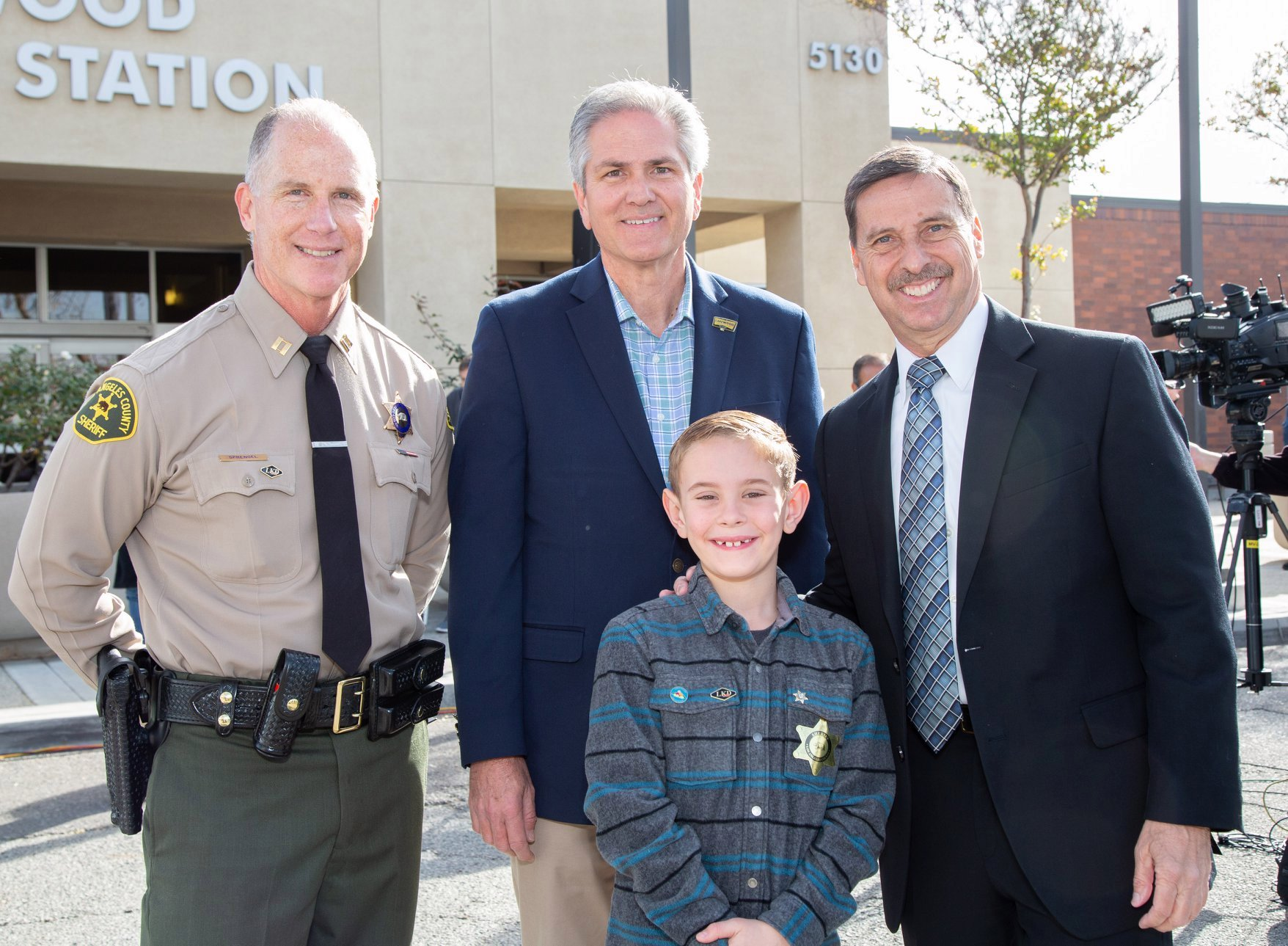 Jaxon Opdyke, 8, is seen with Lakewood city officials on Feb. 5, 2020. (Credit: Lakewood Sheriff's Station)